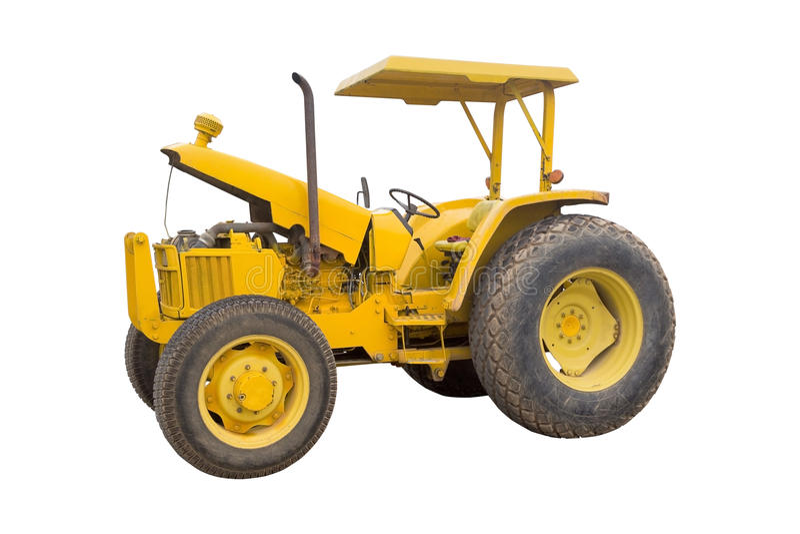 Der alte gelbe Traktor lokalisiert auf weißem Hintergrund stockbilder