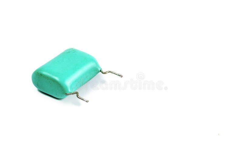 Der alte Kondensator auf einem weißen Hintergrund lizenzfreie stockfotografie