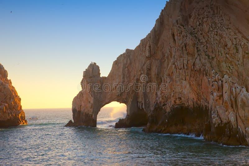 Der Bogen am Sonnenuntergang in Cabo lizenzfreies stockfoto