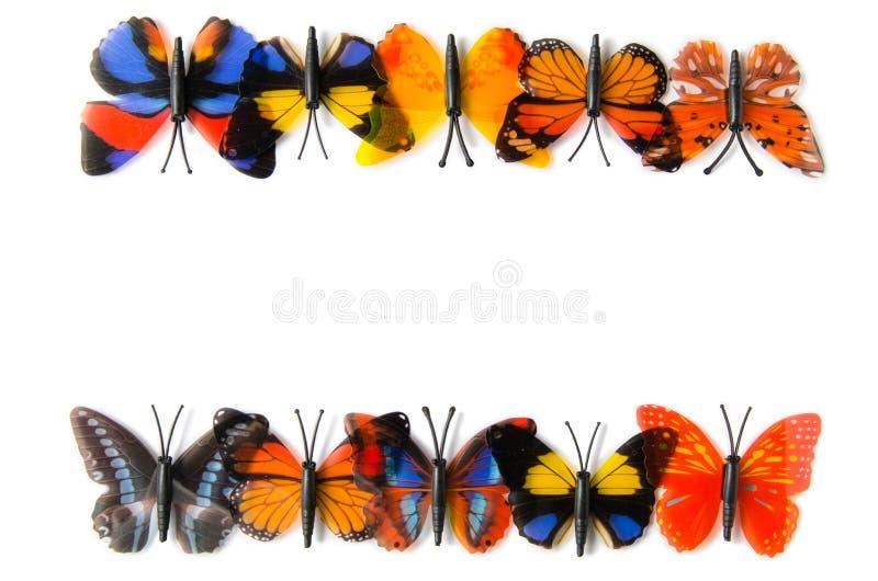 Der bunte Schmetterling lokalisiert auf weißem Hintergrund stockfotografie