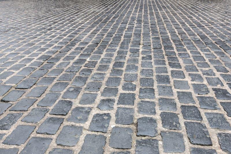 Der cobblestoned Pflasterungshintergrund des Granits stockfoto