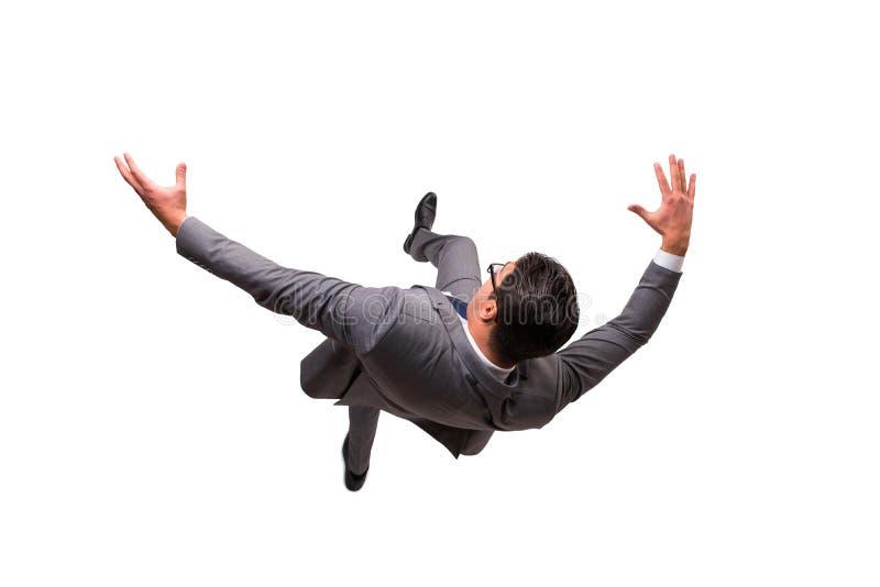Der fallende Geschäftsmann lokalisiert auf dem weißen Hintergrund stockfotos