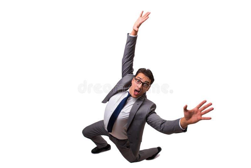 Der fallende Geschäftsmann lokalisiert auf dem weißen Hintergrund stockfotografie