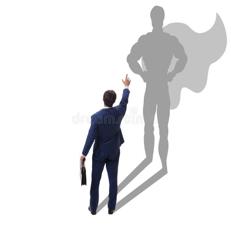 Der Geschäftsmann mit Aspiration des werdenen Superhelden stockfoto