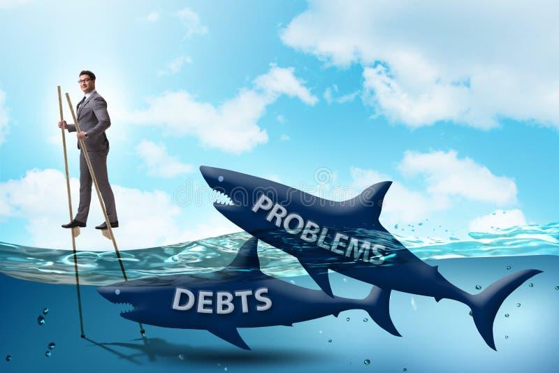 Der Gesch?ftsmann, der erfolgreich Darlehen und Schulden besch?ftigt lizenzfreie abbildung