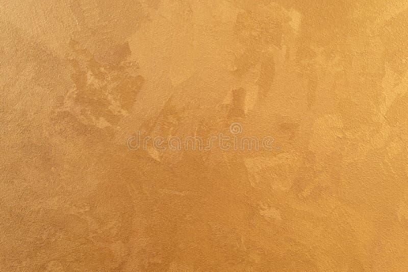 Der Golddekorative Gips von Wänden, intern versorgen Strukturierter Hintergrund lizenzfreie stockfotografie