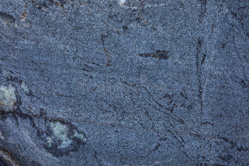 Der Hintergrund oder die Beschaffenheit der Marmorwand des Steinbruchs oder das im Tagebau stockbilder