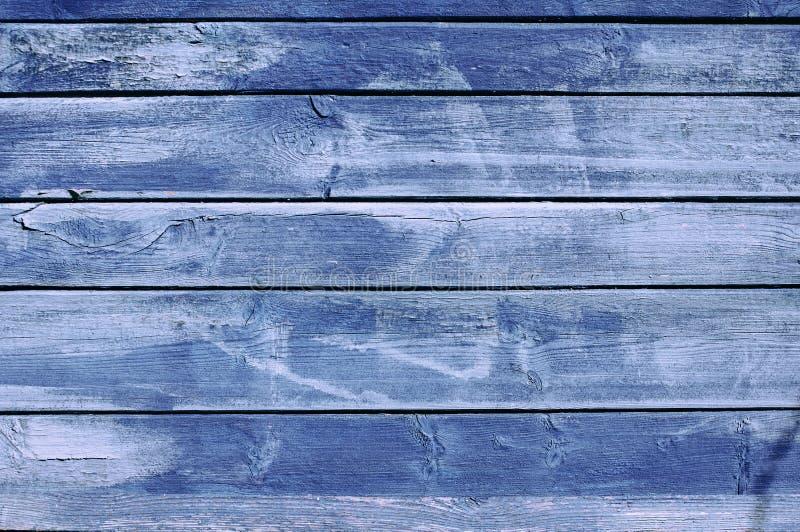 Der Hintergrund vom alten gemalt in den blauen Brettern lizenzfreie stockfotografie