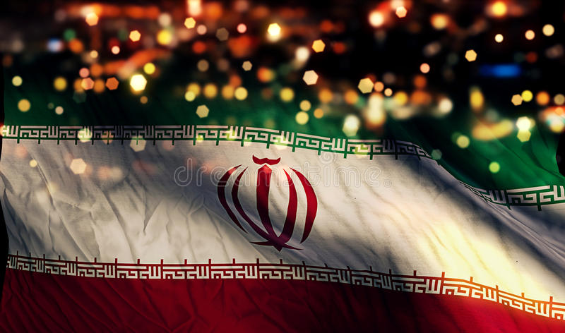 Der Iran-Staatsflagge-Licht-Nacht-Bokeh-Zusammenfassungs-Hintergrund lizenzfreies stockbild
