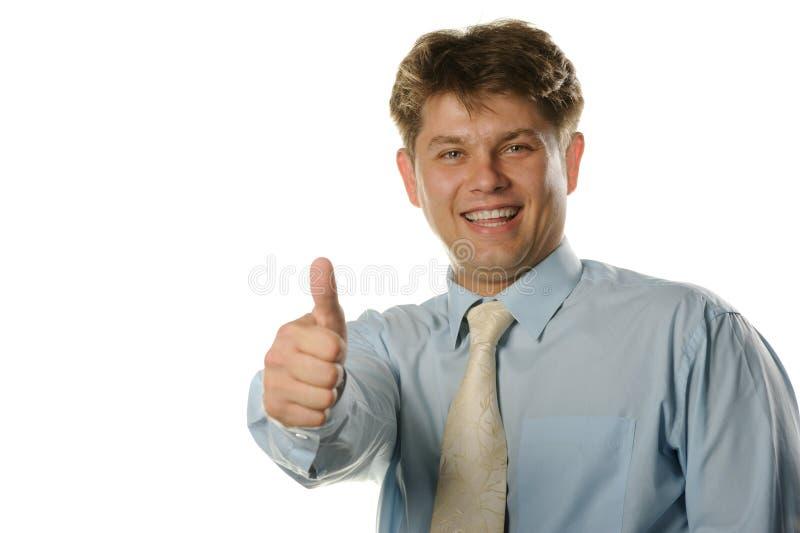 Der junge Geschäftsmann mit anerkennend Geste stockfoto