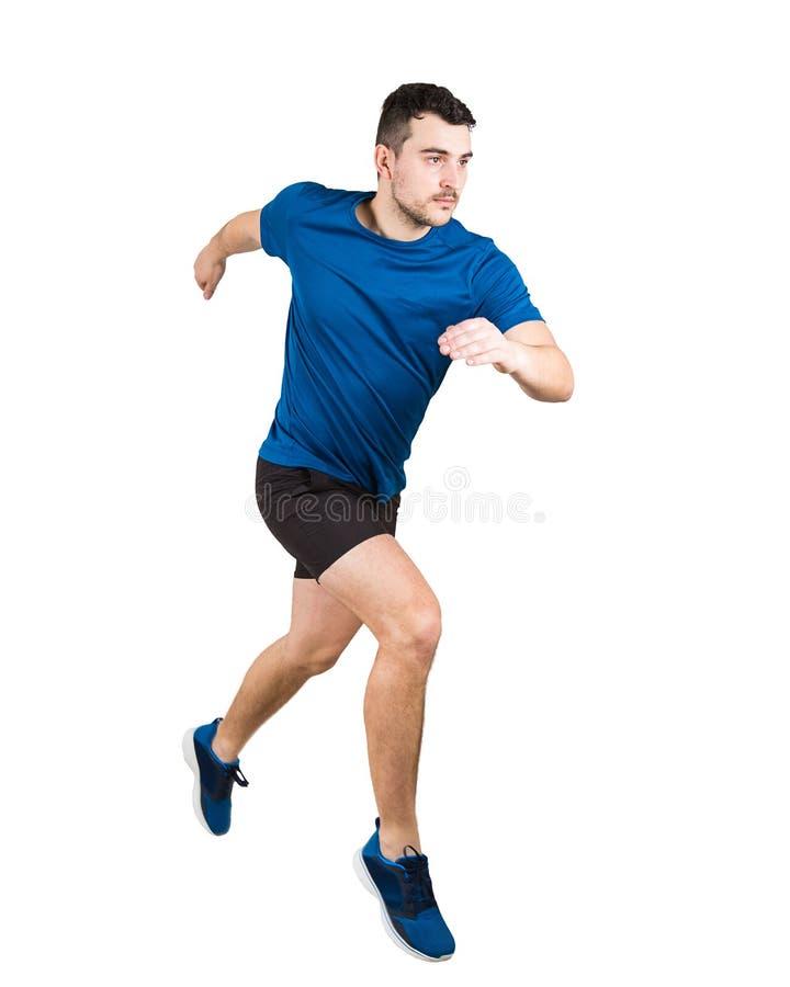 Der junge Kerlläufer, der schwarze und blaue Sportkleidung trägt, macht einen schnellen Sprint lizenzfreie stockbilder