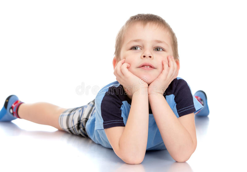 der junge liegt auf dem boden stockfoto bild von kindheit freude 57788598. Black Bedroom Furniture Sets. Home Design Ideas