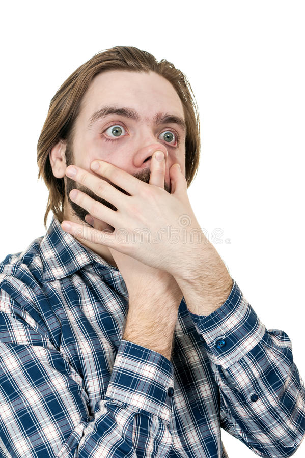 Der junge Mann macht lächerliche Gesichter lizenzfreies stockfoto