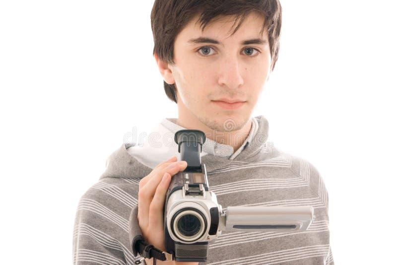 Der junge Mann mit der Video Kamera getrennt stockfotografie