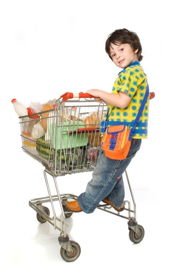 Der Junge mit Wagen für shoop stockbild