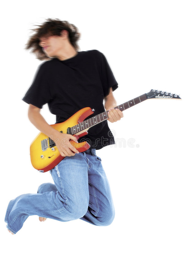 Der Junge springend mit elektrischer Gitarre über Weiß lizenzfreie stockbilder