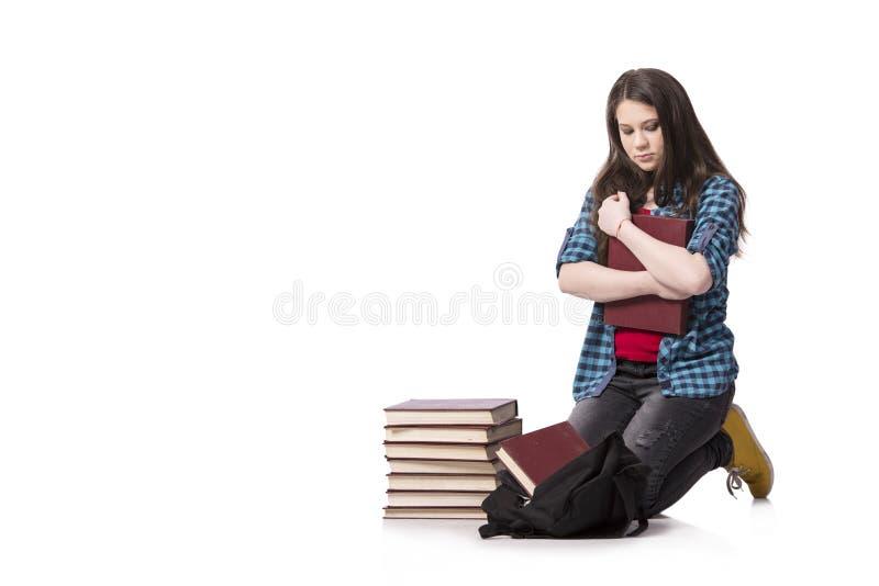 Der junge Student, der für Schulprüfungen sich vorbereitet stockbilder