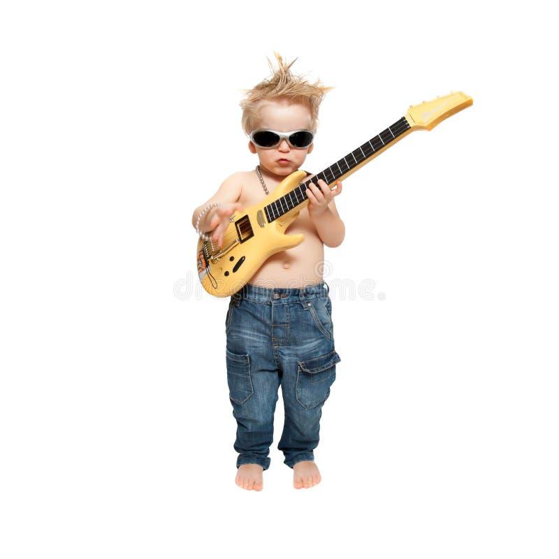 Der Junge und die elektrische Gitarre stockbild