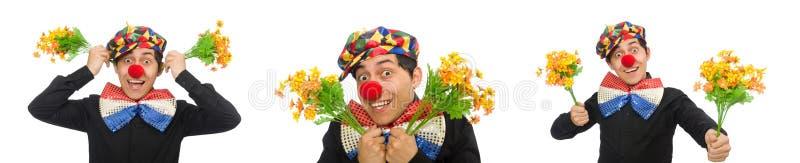 Der lustige Clown mit den Blumen lokalisiert auf Weiß stockbilder
