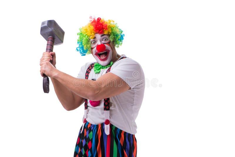 Der lustige Clown mit einem Hammer lokalisiert auf weißem Hintergrund stockbild