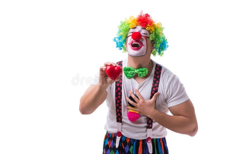 Der lustige Clown mit einem Herzen lokalisiert auf weißem Hintergrund stockbild