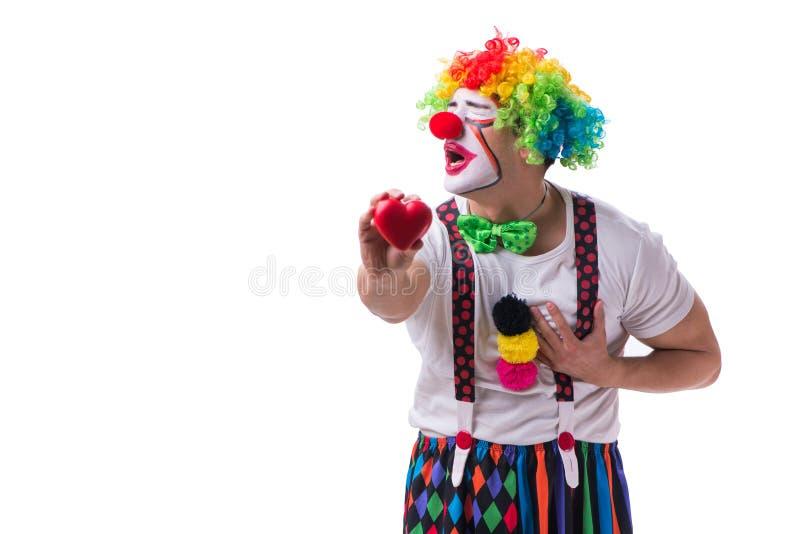 Der lustige Clown mit einem Herzen lokalisiert auf weißem Hintergrund lizenzfreies stockfoto