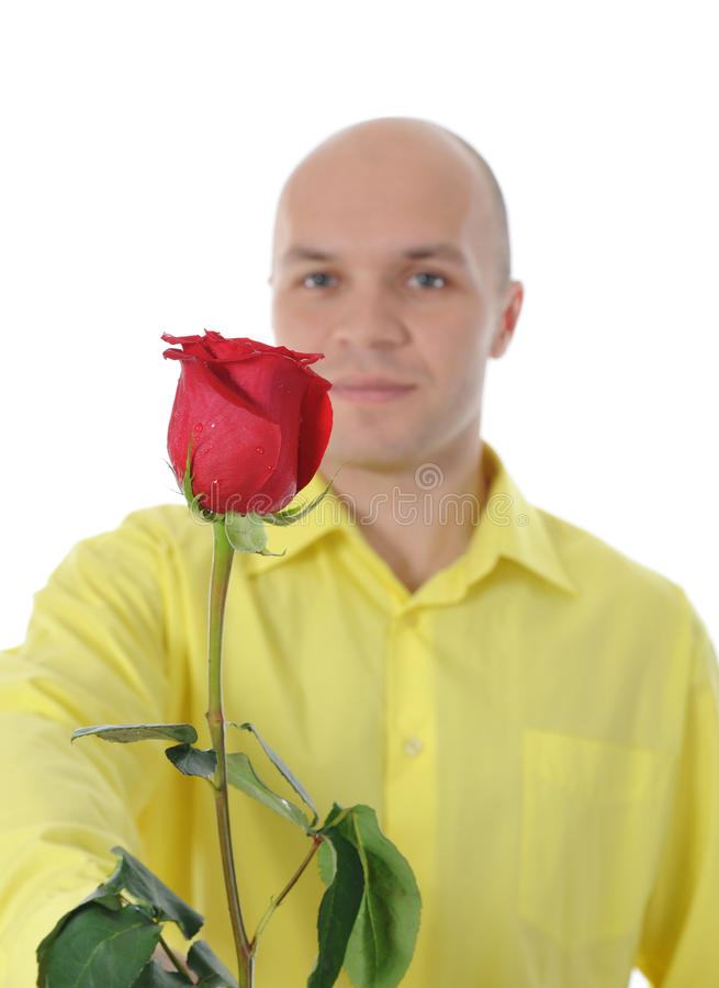 Der Mann, der ein Rotes anhält, stieg stockfotografie