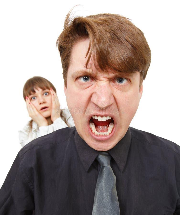 Der Mann, der verärgert ist, war er wütend. Frau in der Grausigkeit. stockbilder