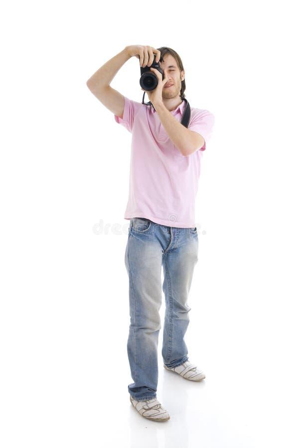Der Mann mit der Kamera getrennt auf einem Weiß stockbild