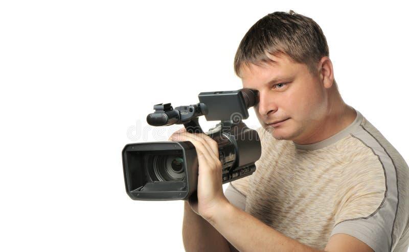 Der Mann mit einer Video Kamera stockbild