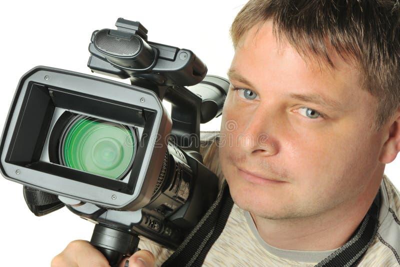 Der Mann mit einer Video Kamera lizenzfreies stockbild