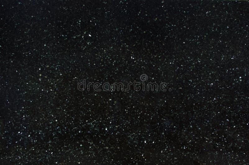 Der natürliche Granit, der mit Scheinen schwarz ist, rief Emerald Pearl an stockbilder
