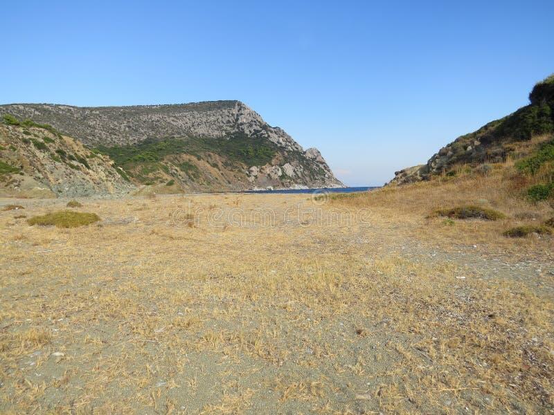 Der Rand der Sithonian-Halbinsel Der letzte Strand von Eden stockfotografie