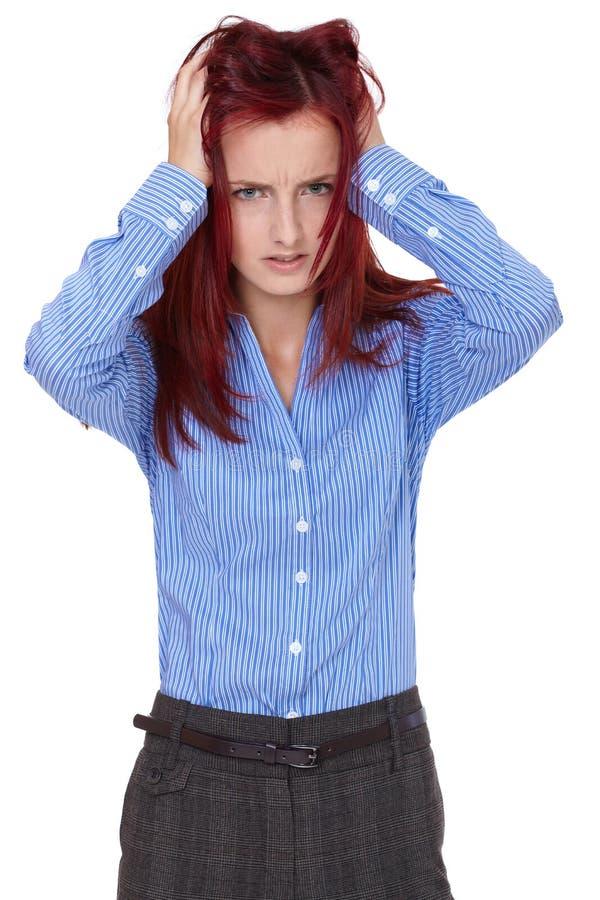 Der Redhead, der weiblich ist, zerreißen ihr Haar heraus, betont lizenzfreies stockfoto