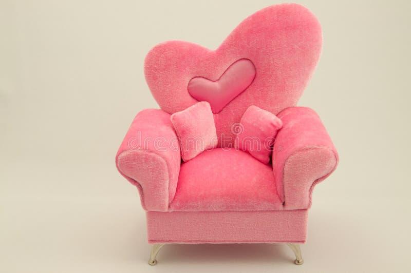 Der rosafarbene Arm-Stuhl lizenzfreie stockfotos