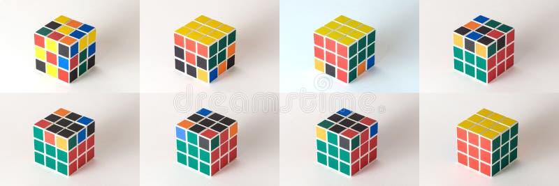 Der Rubik-` s Würfel auf dem weißen Hintergrund lizenzfreies stockbild