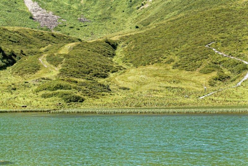 Der Schlappolt See in den Allgäu-Alpen im Bayern lizenzfreie stockfotografie