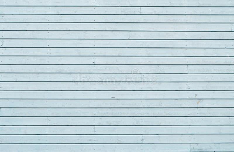 Der Schmutz, welche Blau gemalter Eiche abzieht, verschalt Hintergrund lizenzfreies stockfoto