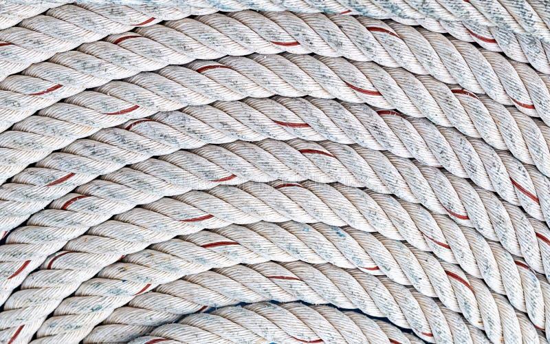 Der Seilhintergrundmarineentwurfsbasis der Runde symmetrisches Muster der umsponnenen weißen Bootsverlegenheits-Yacht der natürli lizenzfreies stockfoto