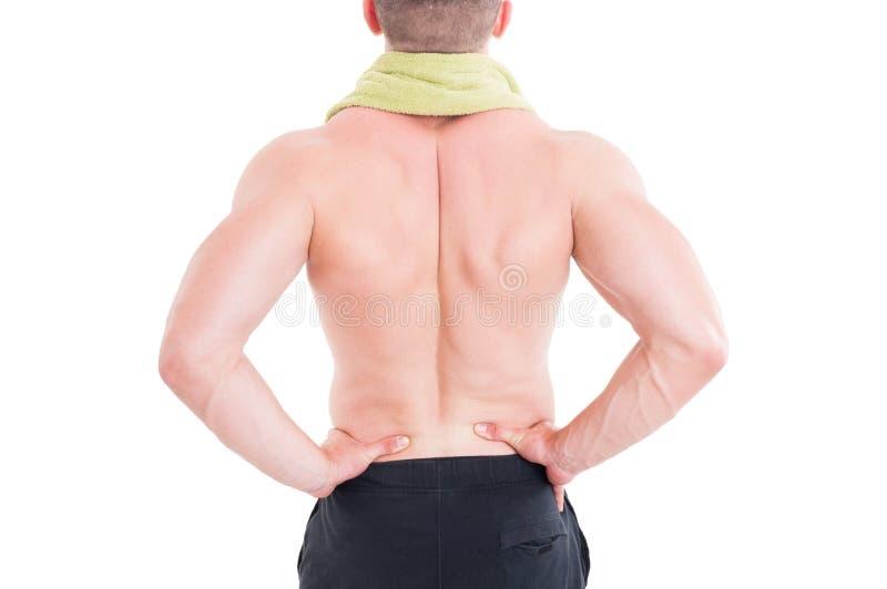 Der sportive Mann, der seinen lumbalen Bereich hält oder, senken zurück lizenzfreies stockbild