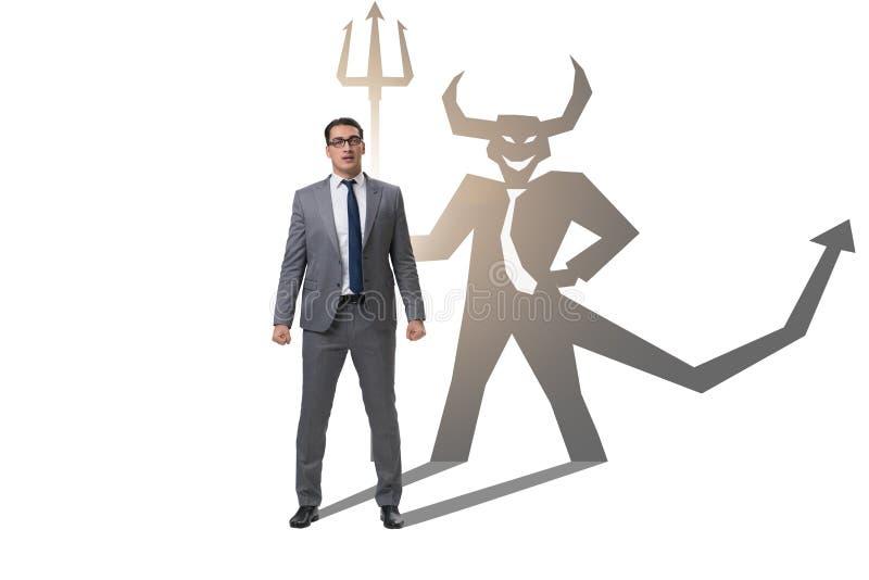 Der Teufel, der im Gesch?ftsmann - alter ego-Konzept sich versteckt lizenzfreies stockfoto