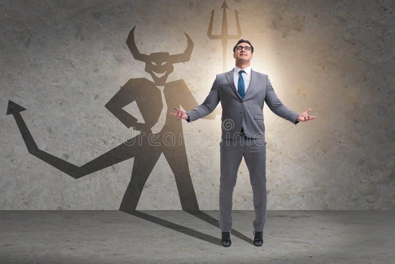 Der Teufel, der im Gesch?ftsmann - alter ego-Konzept sich versteckt stockfoto
