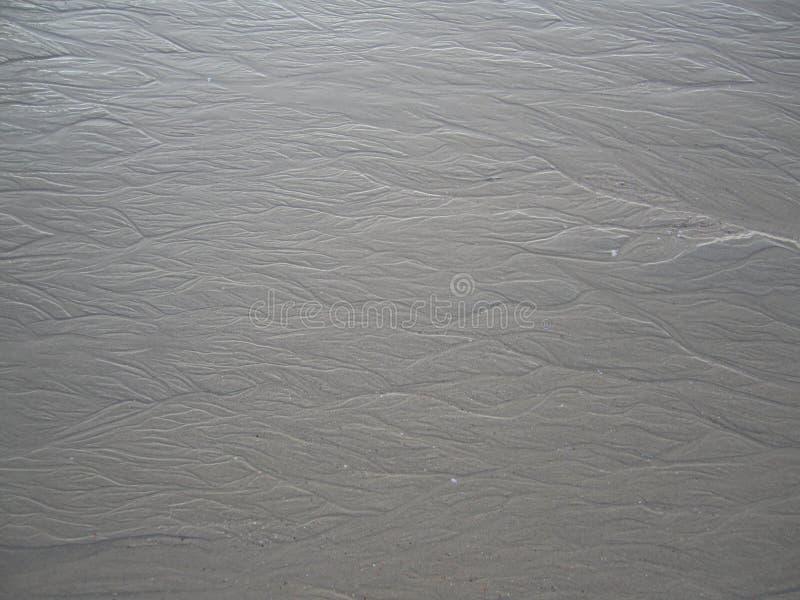 Der Tracery auf dem Sand lizenzfreies stockfoto
