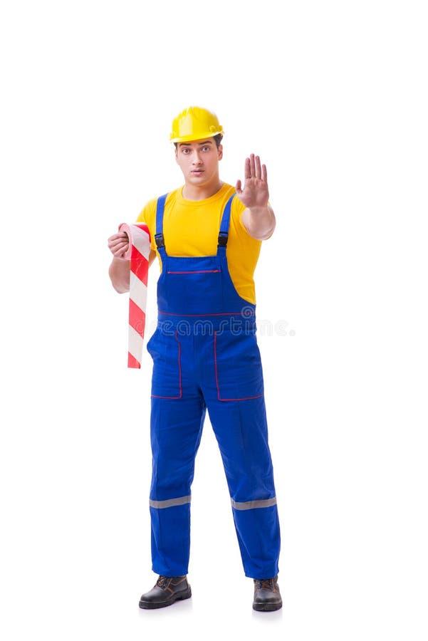 Der tragende Overall der lustigen Arbeitskraft mit Band lizenzfreie stockbilder