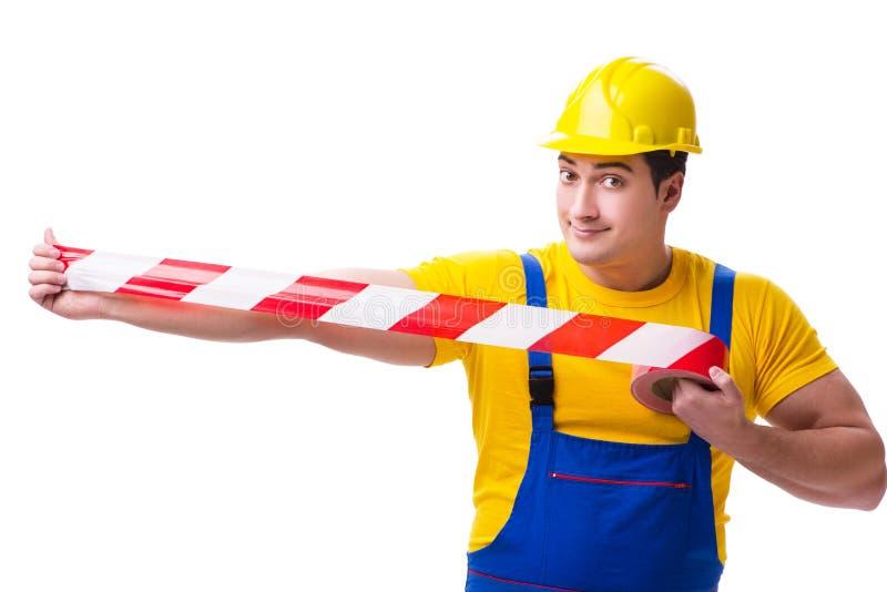 Der tragende Overall der lustigen Arbeitskraft mit Band lizenzfreie stockfotografie