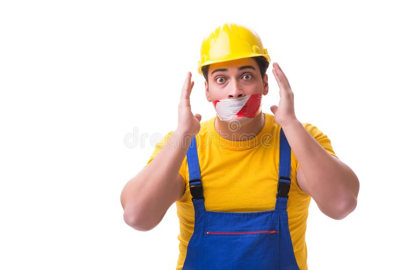 Der tragende Overall der lustigen Arbeitskraft mit Band lizenzfreies stockfoto