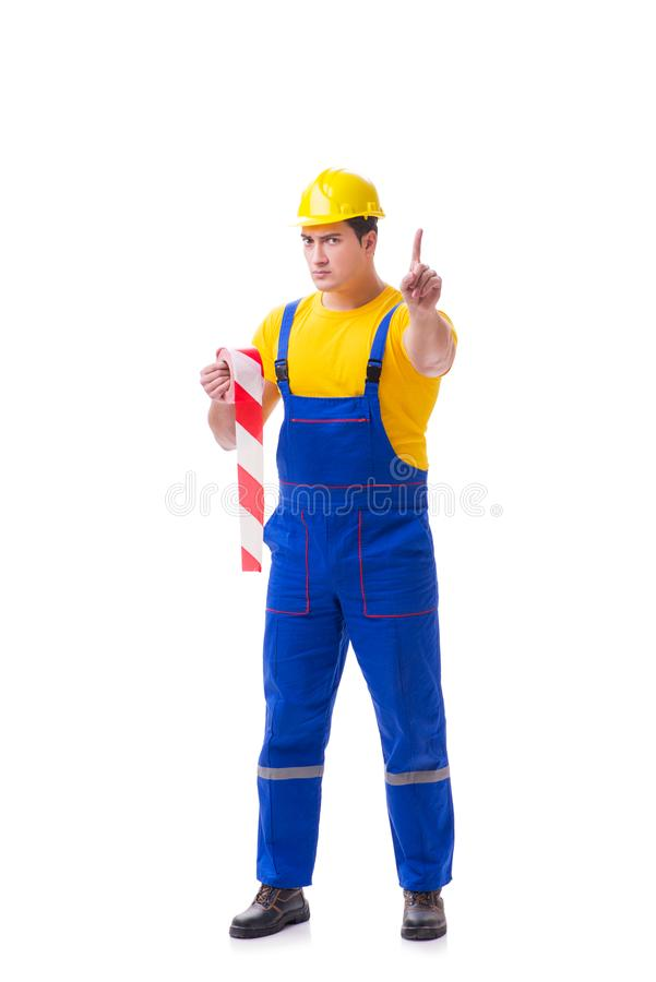Der tragende Overall der lustigen Arbeitskraft mit Band stockfoto