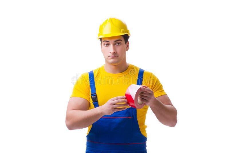 Der tragende Overall der lustigen Arbeitskraft mit Band stockfotos