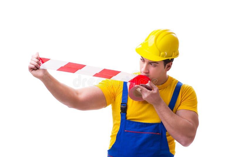 Der tragende Overall der lustigen Arbeitskraft mit Band lizenzfreie stockfotos