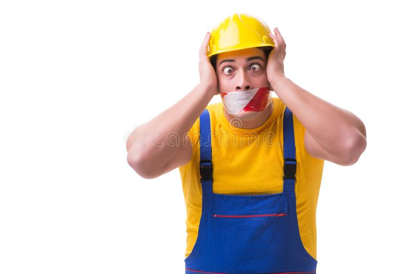 Der tragende Overall der lustigen Arbeitskraft mit Band stockbilder